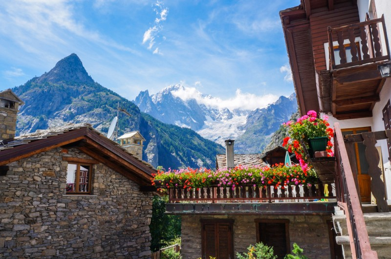 Beautiful traditional house with flowers in Courmayeur, Italy